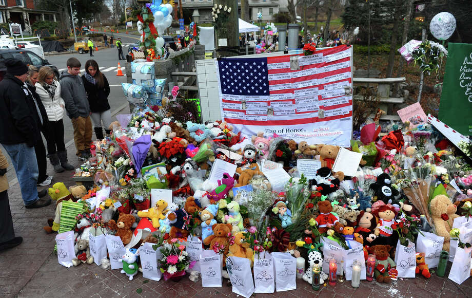 A memorial for victims from last Friday's shooting massacre at Sandy Hook Elementary School in Newtown, Conn. Photo: Christian Abraham / Connecticut Post