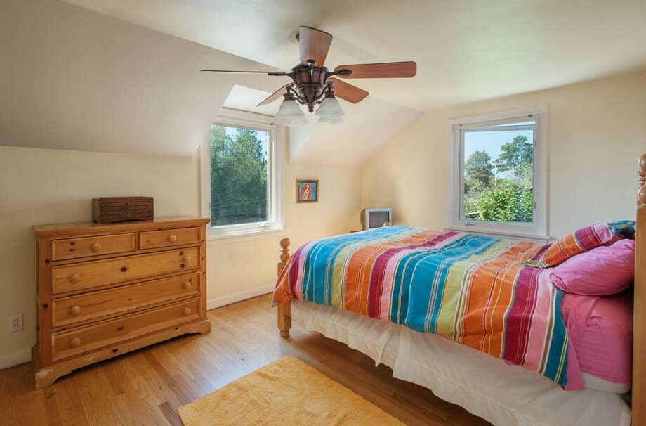 Bedroom of 2608 W. Galer St. The 2,670-square-foot house, built in 1940, has three bedrooms, 1.5 bathrooms, French doors, two fireplaces, a rec room and two decks on a 4,900-square-foot lot. It's listed for $589,000. Photo: Aaron Leitz /Courtesy Virginia And Whitney Mason/Coldwell Banker Bain