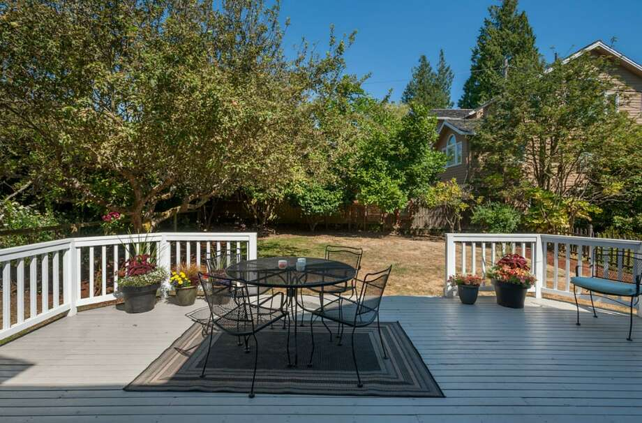 Back deck of 2608 W. Galer St. The 2,670-square-foot house, built in 1940, has three bedrooms, 1.5 bathrooms, French doors, two fireplaces, a rec room and two decks on a 4,900-square-foot lot. It's listed for $589,000. Photo: Aaron Leitz /Courtesy Virginia And Whitney Mason/Coldwell Banker Bain