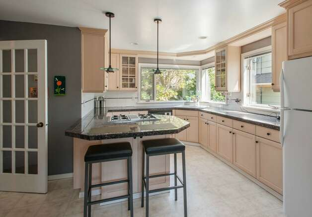 Kitchen of 2608 W. Galer St. The 2,670-square-foot house, built in 1940, has three bedrooms, 1.5 bathrooms, French doors, two fireplaces, a rec room and two decks on a 4,900-square-foot lot. It's listed for $589,000. Photo: Aaron Leitz /Courtesy Virginia And Whitney Mason/Coldwell Banker Bain