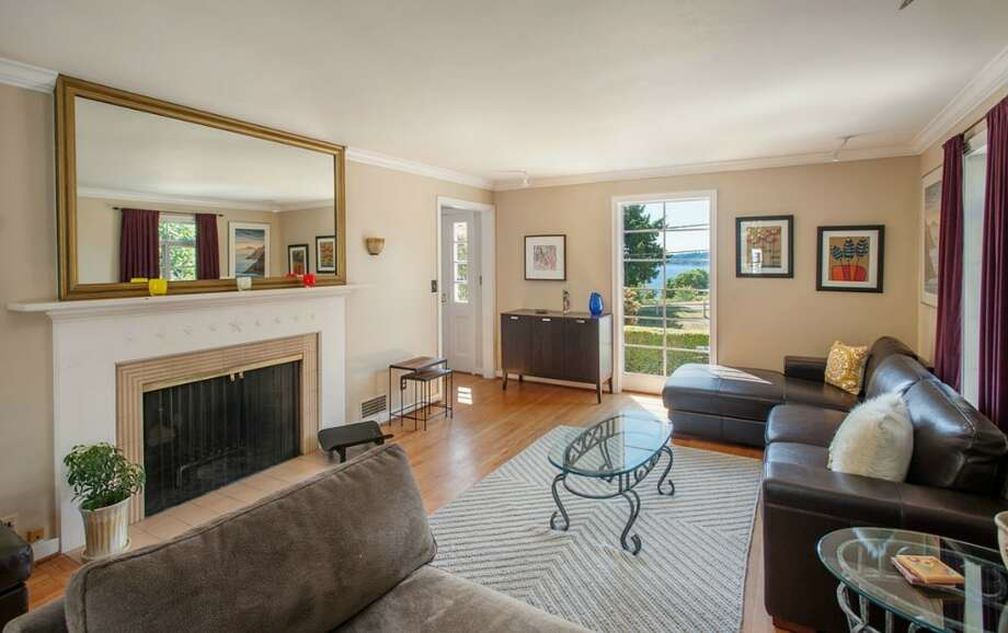 Living room of 2608 W. Galer St. The 2,670-square-foot house, built in 1940, has three bedrooms, 1.5 bathrooms, French doors, two fireplaces, a rec room and two decks on a 4,900-square-foot lot. It's listed for $589,000. Photo: Aaron Leitz /Courtesy Virginia And Whitney Mason/Coldwell Banker Bain