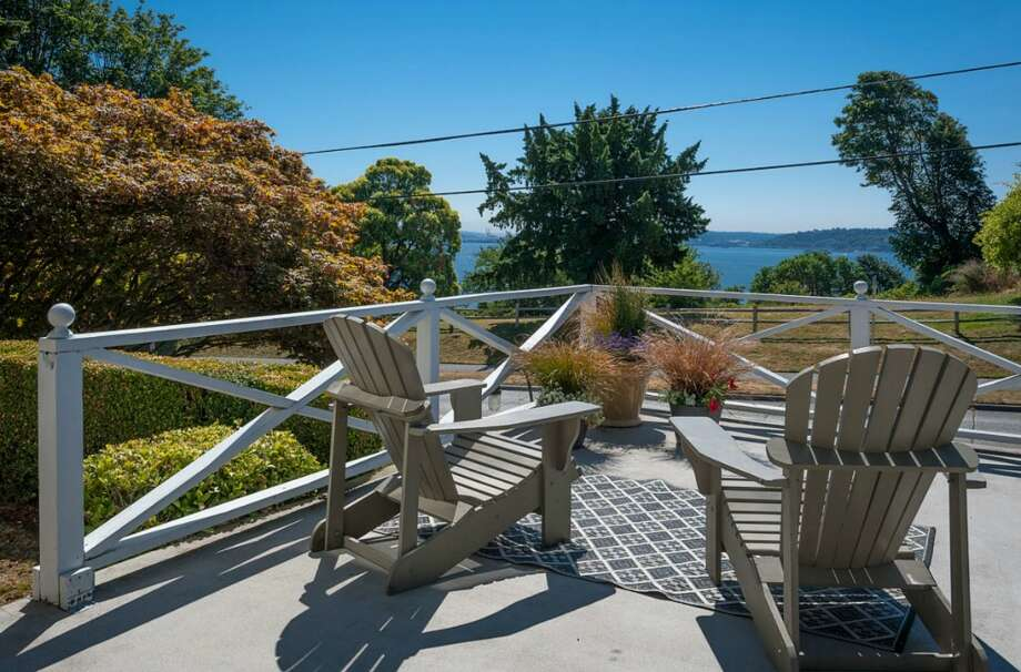 Front deck of 2608 W. Galer St. The 2,670-square-foot house, built in 1940, has three bedrooms, 1.5 bathrooms, French doors, two fireplaces, a rec room and two decks on a 4,900-square-foot lot. It's listed for $589,000. Photo: Aaron Leitz /Courtesy Virginia And Whitney Mason/Coldwell Banker Bain
