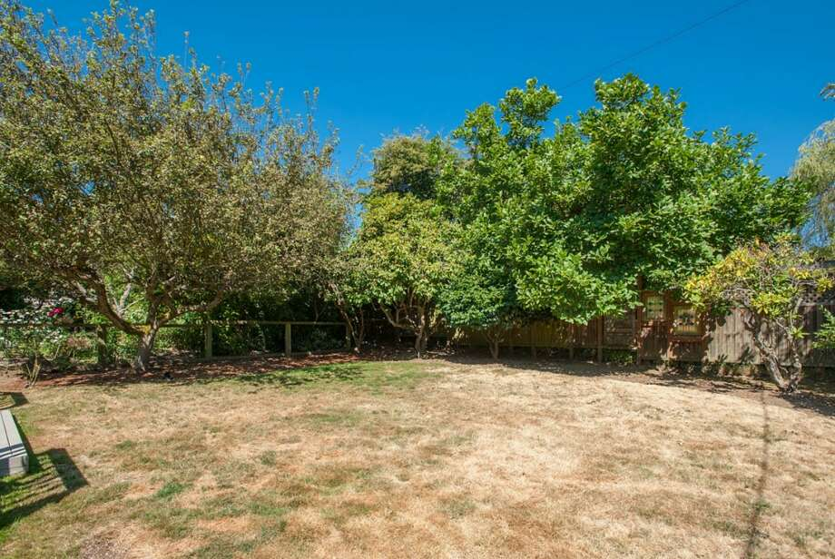 Back yard of 2608 W. Galer St. The 2,670-square-foot house, built in 1940, has three bedrooms, 1.5 bathrooms, French doors, two fireplaces, a rec room and two decks on a 4,900-square-foot lot. It's listed for $589,000. Photo: Aaron Leitz /Courtesy Virginia And Whitney Mason/Coldwell Banker Bain