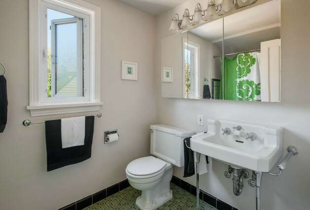 Bathroom of 2608 W. Galer St. The 2,670-square-foot house, built in 1940, has three bedrooms, 1.5 bathrooms, French doors, two fireplaces, a rec room and two decks on a 4,900-square-foot lot. It's listed for $589,000. Photo: Aaron Leitz /Courtesy Virginia And Whitney Mason/Coldwell Banker Bain