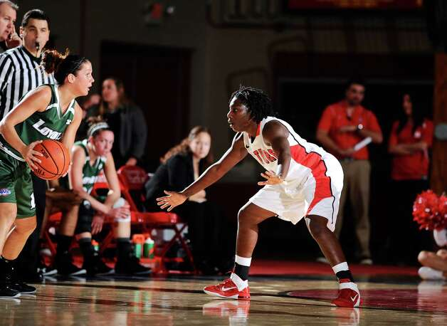 Daphne Elliott plays defense in the University of Hartford's 2012 season-opener against Loyola (Md.). Photo: Contributed Photo / Fairfield Citizen