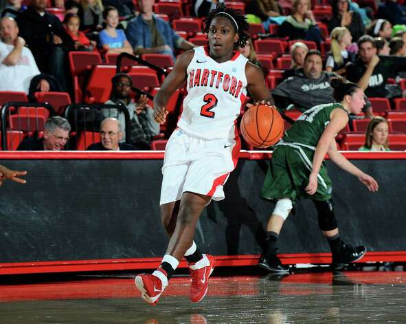 University of Hartford guard, and Fairfield-native, Daphne Elliott sets up to shoot against Loyola (Md.). Photo: Contributed Photo / STEVE MCLAUGHLIN