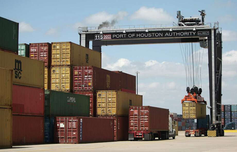 A container is lifted off a truck at the Bayport terminal, part of the Port of Houston Authority. Photo: Karen Warren, Staff / © 2012  Houston Chronicle