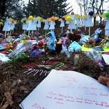 A memorial site  is seen Thursday, December 20, 2012 in Newtown, Conn., honoring the individuals who were killed during a shooting at Sandy Hook Elementary School last Friday. The school was evacuated after Adam Lanza opened fire killing 26 individuals, 20 whom were children.