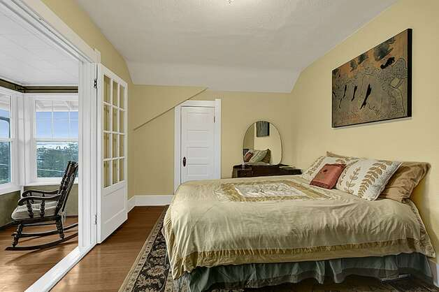 Master bedroom of 2005 23rd Ave. W. The 2,810-square-foot house, built in 1909, has four bedrooms, 2.25 bathrooms, vaulted ceilings, period fixtures, radiators, an enclosed porch, a family room, a patio and a two-car garage on a 3,675-square-foot lot. It's listed for $629,000. Photo: Courtesy Redfin