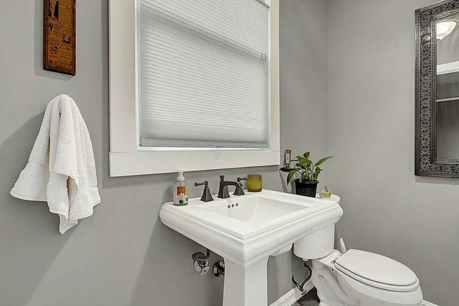Bathroom of 2005 23rd Ave. W. The 2,810-square-foot house, built in 1909, has four bedrooms, 2.25 bathrooms, vaulted ceilings, period fixtures, radiators, an enclosed porch, a family room, a patio and a two-car garage on a 3,675-square-foot lot. It's listed for $629,000. Photo: Courtesy Redfin