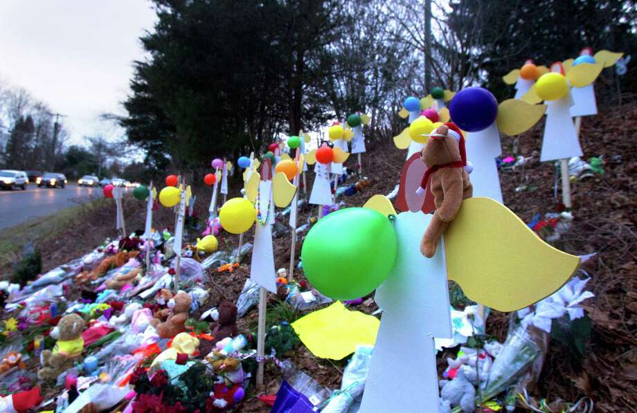 A memorial site  is seen Thursday, December 20, 2012 in Newtown, Conn., honoring the individuals who were killed during a shooting at Sandy Hook Elementary School last Friday. The school was evacuated after Adam Lanza opened fire killing 26 individuals, 20 whom were children. Photo: Cody Duty, Cody Duty/Hearst Newspapers / The News-Times