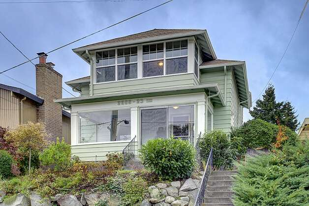 Next comes 2005 23rd Ave. W. The 2,810-square-foot house, built in 1909, has four bedrooms, 2.25 bathrooms, vaulted ceilings, period fixtures, radiators, an enclosed porch, a family room, a patio and a two-car garage on a 3,675-square-foot lot. It's listed for $629,000. Photo: Courtesy Redfin