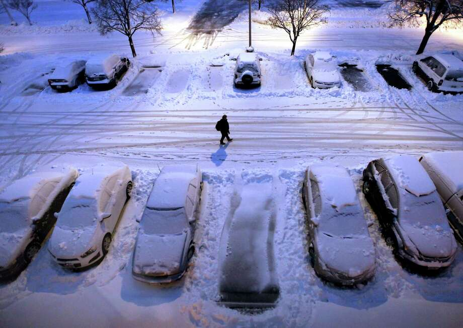 Snow-covered cars in a parking lot greet early morning risers in Madison, Wis. as a severe winter storm moves through the upper Midwest Thursday, Dec. 20, 2012. (AP Photo/Wisconsin State Journal, John Hart) Photo: John Hart