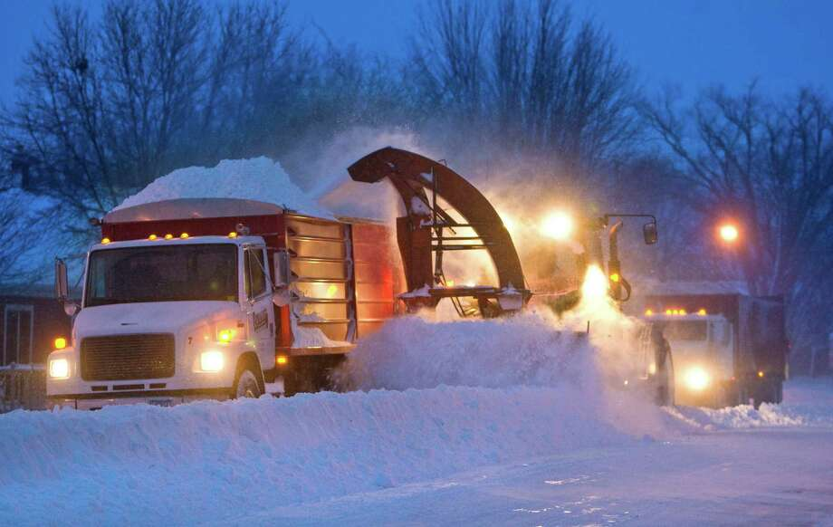 Snow clearing crews in Pine Island, Minn were out early trying to clear roads before morning commuters headed to work on Thursday, Dec. 20, 2012. The first major snowstorm of the season began its slow eastward march across the Midwest early Thursday, creating treacherous driving conditions and threatening to disrupt some of the nation's busiest airports ahead of the holiday weekend. (AP Photo/The Rochester Post-Bulletin, Jerry Olson) Photo: Jerry Olson