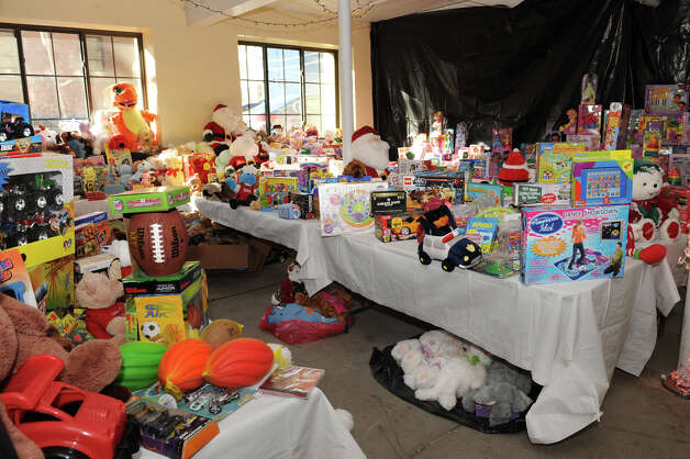 Hundreds of holiday gifts are ready to be given out for Christmas Day at the Capital City Rescue Mission Thursday Dec. 20, 2012 in Albany, N.Y. Presents were separated by age group and gender. (Lori Van Buren / Times Union) Photo: Lori Van Buren