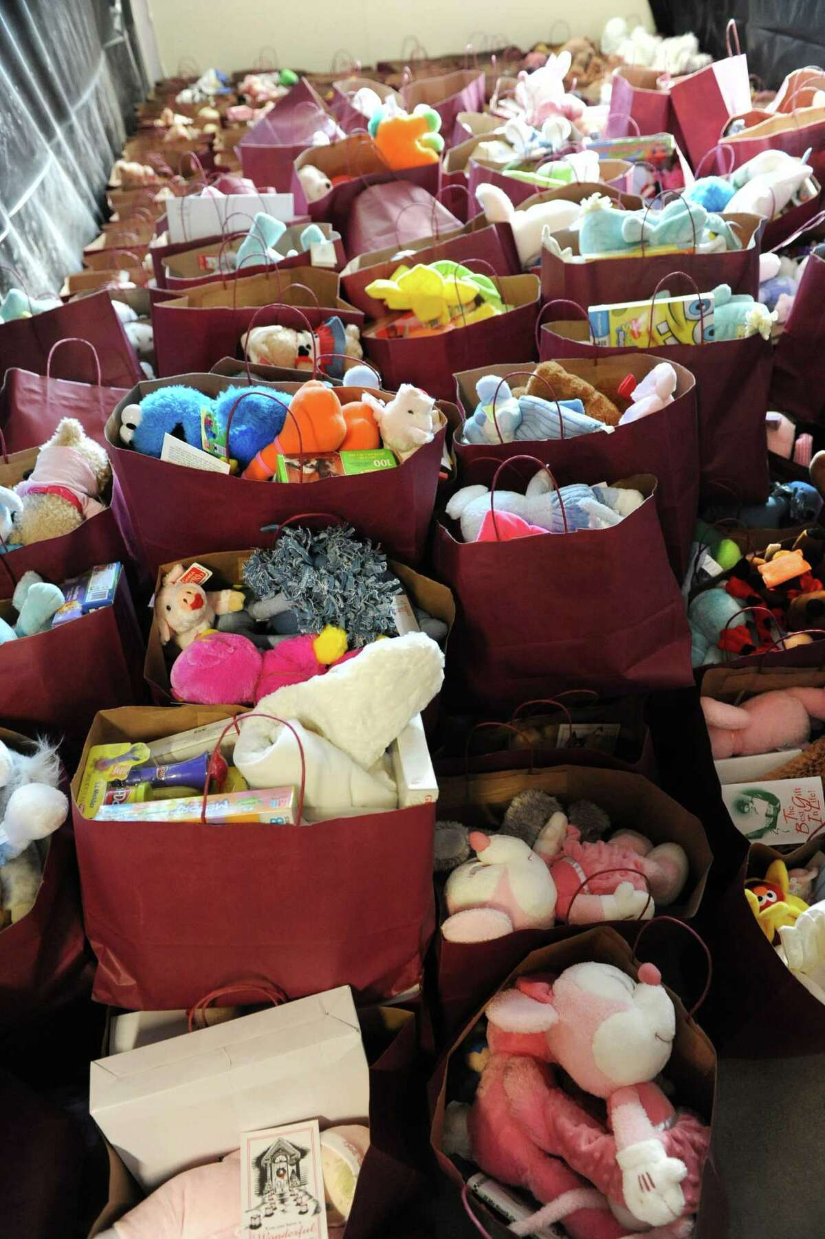 Hundreds of holiday gifts are ready to be given out for Christmas Day at the Capital City Rescue Mission Thursday Dec. 20, 2012 in Albany, N.Y. Presents were separated by age group and gender. (Lori Van Buren / Times Union)