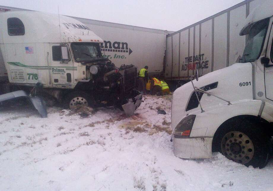 This photo provided by the Iowa State Patrol shows the scene of a 25-vehicle pileup that killed three people Thursday, Dec. 20, 2012 north of Des Moines, Iowa.  Authorities said drivers were blinded by blowing snow and didn't see vehicles that had slowed or stopped on Interstate 80 about 60 miles north of Des Moines. A chain reaction of crashes involving semitrailers and passenger cars closed down a section of the highway. Photo: Associated Press / Iowa State Patrol
