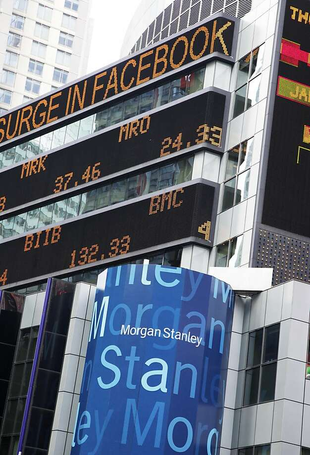 News about Facebook stock flashes across the ticker on Morgan Stanley headquarters in May. The bank has settled with Massachusetts regulators. Photo: Mark Lennihan, Associated Press