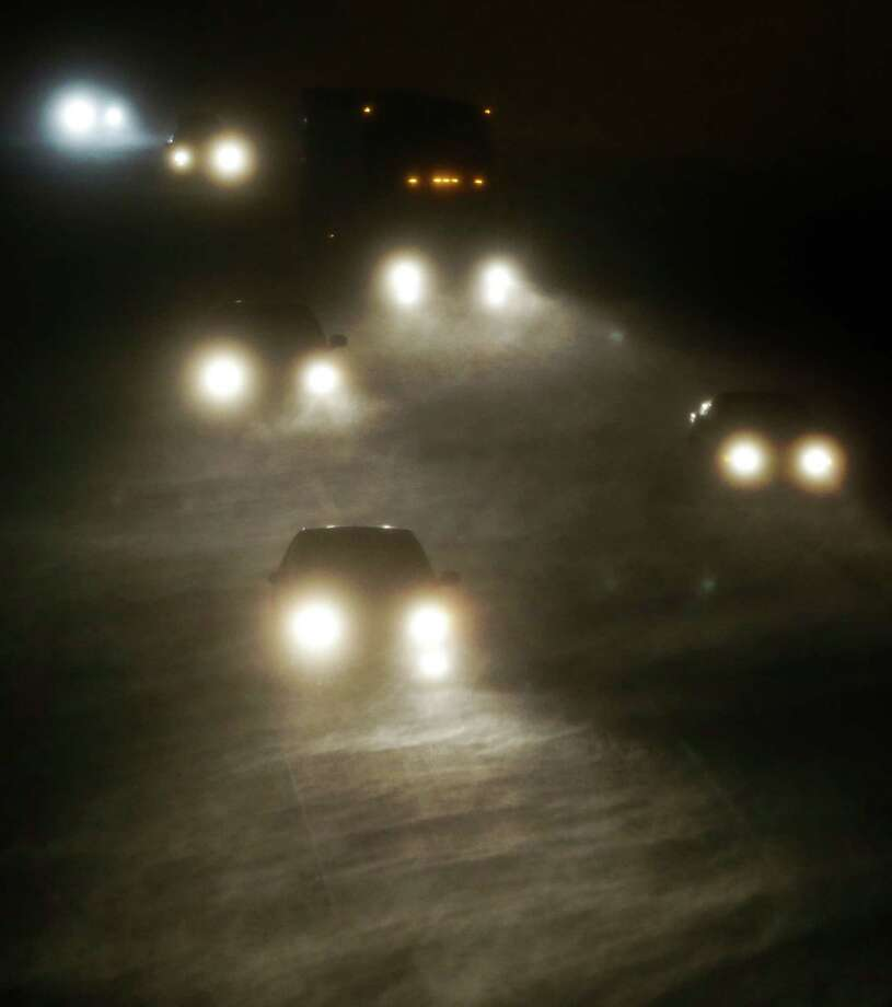 Early morning motorists travel west along I-70 and into a winter storm near  Lawrence, Kan., Thursday, Dec. 20, 2012. Winter weather advisories are in effect for the area. The Midwest's first major snowstorm of the season was sweeping across several states early Thursday, shuttering schools, creating treacherous roadways and threatening to slow down one of the nation's busiest airports ahead of the holiday weekend. Photo: Orlin Wagner, Associated Press / AP