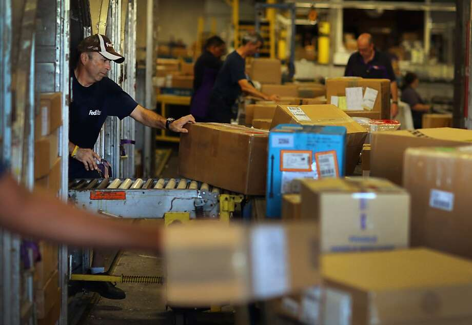 Free shipping via FedEx centers like this one in Doral, Fla., help boost online retailers' sales and customer loyalty, especially around Christmas. Photo: Joe Raedle, Getty Images