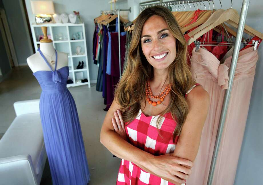 "Kim Spradlin: ""I'd have the sunnyside-up pizza from Drew's American Grill in Stone Oak,"" says Spradlin, ""Survivor"" winner and owner of the Bella Bridesmaid dress shop on Broadway. ""There's lots of protein there to carry you into the afterlife."" Photo: BOB OWEN, Express-News File Photo / © 2012 San Antonio Express-News"
