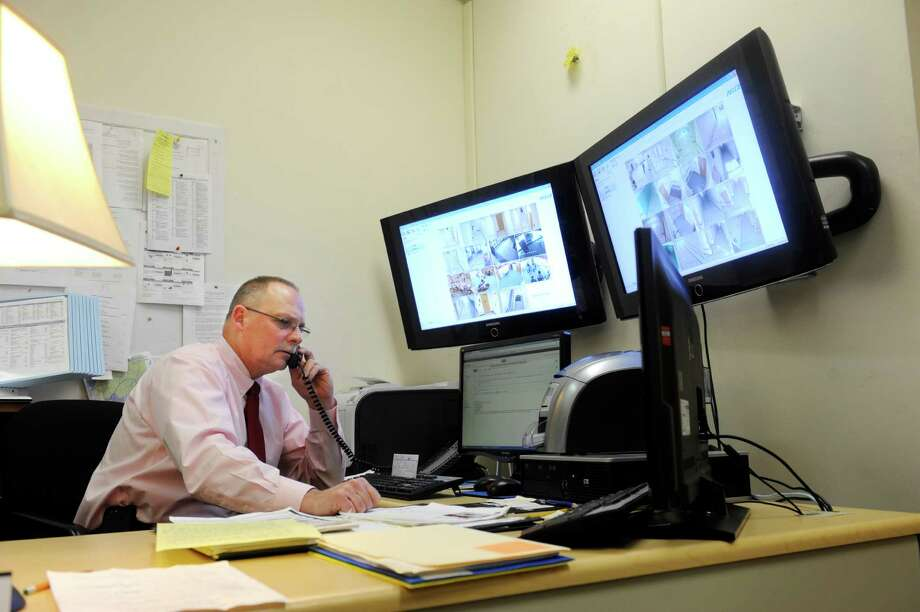 Tom Bobkowski, the Greenwich school district's director of school safety services, sits in his office at the Havemeyer Building in Greenwich, Conn., Thursday, Dec. 20, 2012. Bobkowski lives in Sandy Hook and was at the school Friday, Dec. 14, 2012, in the aftermath of shooting. The event has prompted the need to examine school security in Greenwich. Photo: Helen Neafsey / Greenwich Time