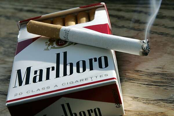 A Marlboro cigarette burns as it sits on a pack of Marlboro cigarettes  Wednesday, Jan. 31, 2007 in  Trenton, N.J. Altria Group Inc., the food and tobacco conglomerate, on Wednesday said fourth-quarter profit rose 29.3 percent on the strength of acquisitions, favorable currency comparisons and pricing strength internationally. (AP Photo/Mel Evans)   A Marlboro cigarette burns as it sits on a pack of Marlboro cigarettes Wednesday, Jan. 31, 2007 in Trenton, N.J. Altria Group Inc., the food and tobacco conglomerate, on Wednesday said fourth-quarter profit rose 29.3 percent on the strength of acquisitions, favorable currency comparisons and pricing strength internationally. (AP Photo/Mel Evans)