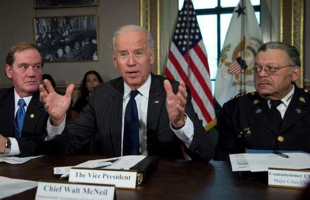 Vice President Joe Biden, flanked by the President of the National Association of Police Organizations and Boston police officer, Thomas Nee, left, and President of the Police Executive Research Forum and Major Cities Chiefs Association and Philadelphia Police Commissioner Charles Ramsey, right, speaks during a meeting at the  Eisenhower Executive Office Building in the White House complex, Thursday, Dec. 20, 2012, in Washington.  Biden is leading a task force that will look at ways of reducing gun violence.    (AP Photo/Carolyn Kaster) Photo: Carolyn Kaster
