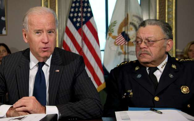 Vice President Joe Biden, with President of the Police Executive Research Forum and Major Cities Chiefs Association and Philadelphia Police Commissioner Charles Ramsey, speaks during a meeting at the  Eisenhower Executive Office Building in the White House complex, Thursday, Dec. 20, 2012, in Washington.  Biden is leading a task force that will look at ways of reducing gun violence.    (AP Photo/Carolyn Kaster) Photo: Carolyn Kaster