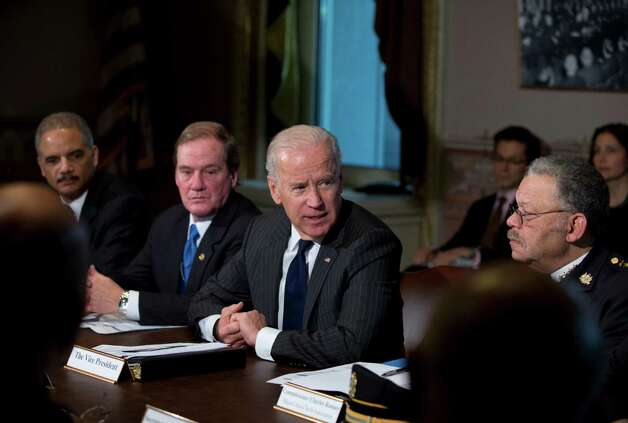 Vice President Joe Biden, second from right, with Attorney General Eric Holder, left, President of the National Association of Police Organizations and Boston police officer, Thomas Nee, second from left, and President of the Police Executive Research Forum and Major Cities Chiefs Association and Philadelphia Police Commissioner Charles Ramsey,  right, speaks to media during a meeting at the Eisenhower Executive Office Building in the White House complex, Thursday, Dec. 20, 2012, in Washington.  Biden is leading a task force that will look at ways of reducing gun violence.      (AP Photo/Carolyn Kaster) Photo: Carolyn Kaster
