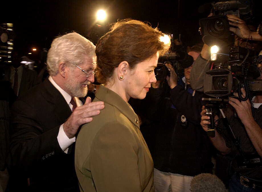 "Clara Harris leaves the courthouse with her lawyer George Parnham during her February 2003 trial in which she was convicted in her husband's death.  She was sentenced to 20 years after jurors decided she acted with ""sudden passion."" Photo: SMILEY N. POOL, STAFF / Houston Chronicle"