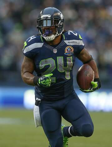 SEATTLE, WA - DECEMBER 09:  Running back Marshawn Lynch #24 of the Seattle Seahawks rushes against the Arizona Cardinals at CenturyLink Field on December 9, 2012 in Seattle, Washington. The Seahawks defeated the Cardinals 58-0.  (Photo by Otto Greule Jr/Getty Images) Photo: Otto Greule Jr, Getty Images