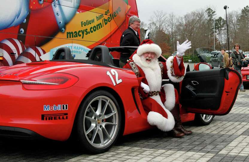 Macy's Santa visits children from the Make-A-Wish Foundation at the Barber Motorsports Park during h