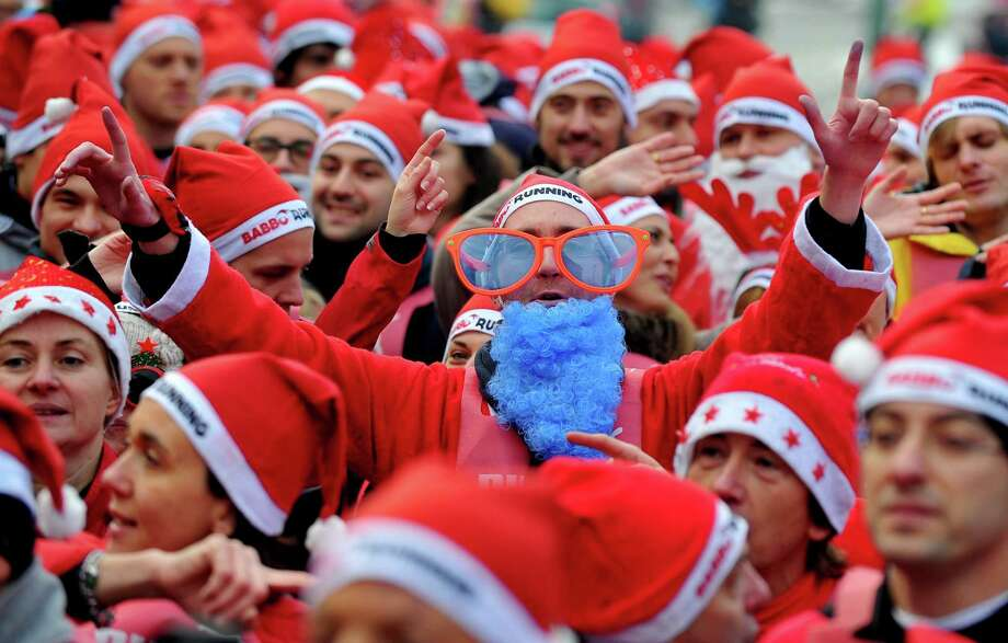 People wear costumes as they take part in a Santa Claus themed race in downtown Milan on December 16, 2012. Photo: TIZIANA FABI, AFP/Getty Images / AFP