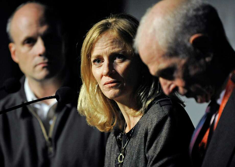 FILE - This Nov. 2, 2012 file photo shows Mary Wittenberg, president of the New York Road Runners, speaking during a news conference in New York, after New York Mayor Michael Bloomberg cancelled the New York City Marathon. At left is Howard Wolfson, deputy mayor for government affairs and communication; at right is George Hirsch, chairman of the board of New York Road Runners. New York City Marathon runners can receive a refund of their entry fee after this year's race was canceled because of Superstorm Sandy. The refund applies only to runners who had not withdrawn before Oct. 24, when forecasts of a massive storm started to emerge. (AP Photo/Louis Lanzano, FIle) Photo: Louis Lanzano