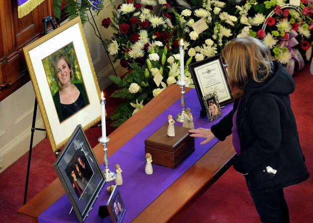 A mourner pays her respects at a funeral service for shooting victim Lauren Rousseau, Thursday, Dec. 20, 2012, at the First Congregational Church in Danbury, Conn. Photo: Carol Kaliff / The News-Times