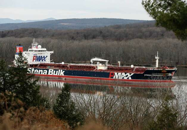 The Stena Primorsk is anchored on the Hudson River on Thursday, Dec. 20, 2012 in Stuyvesant, N.Y. U.S. Coast Guard Petty Officer Erik Swanson says the 600-foot oil tanker reported losing steering and grounding 10 miles south of the Port of Albany at about 9 a.m. Thursday. He says the crew of the ship carrying 6 million gallons of light crude oil was able to free it and safely anchor nearby. (AP Photo/Mike Groll) Photo: Mike Groll