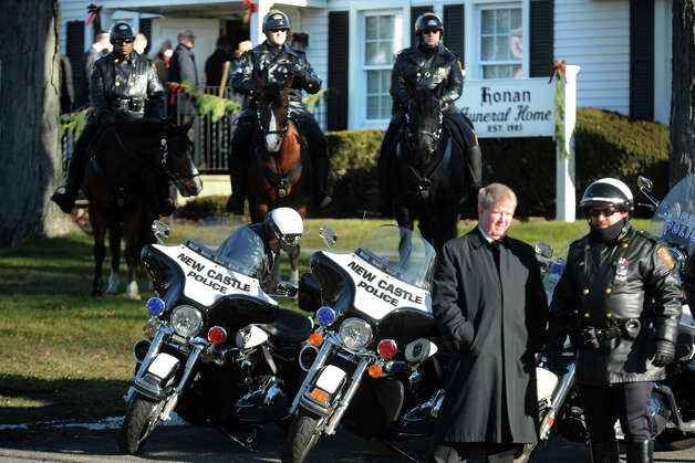 The Bridgeport Police Department mounted unit stand guard at the funeral service for Jesse McCord Lewis, at the Honan Funeral Home in Newtown, Conn., Dec. 20th, 2012. Lewis is one of twenty students killed in the mass shooting at Sandy Hook Elementary School last Friday. Photo: Ned Gerard / Connecticut Post