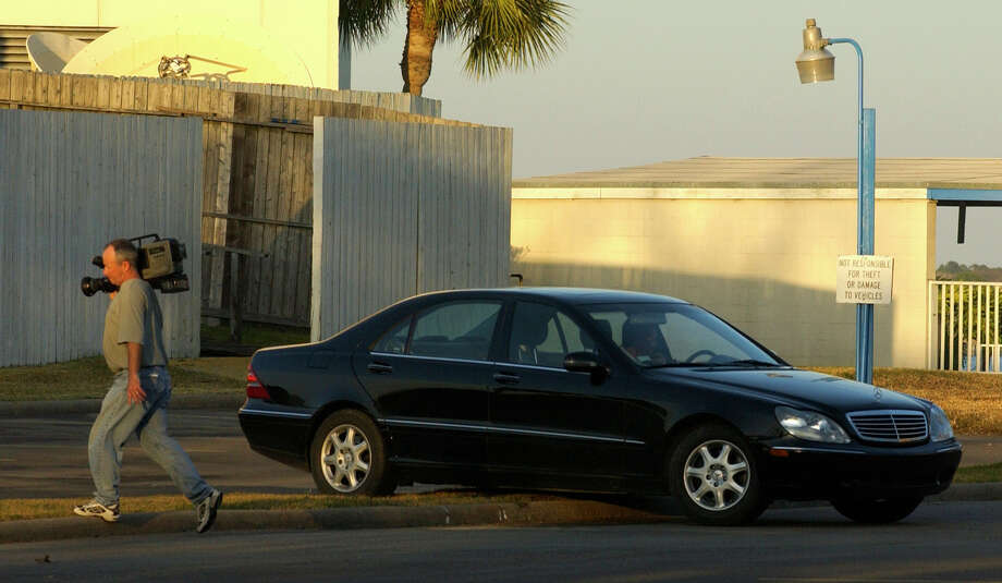 In 2003, crews working for Harris' defense team videotape a black Mercedes in the parking lot of the Nassau Bay Hilton, where David Harris was killed.