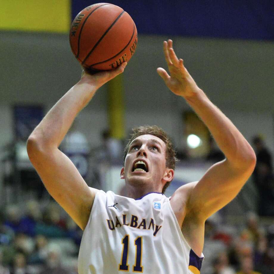 UAlbany's #11 Luke Devlin shoots against Duquesne at the Sefcu Arena in Albany Friday Nov. 9, 2012.   (John Carl D'Annibale / Times Union) Photo: John Carl D'Annibale / 10019888A