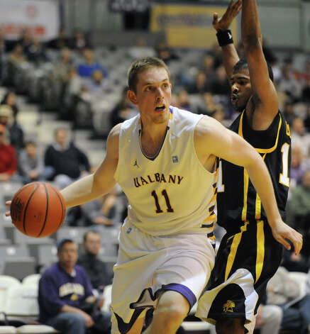 UAlbany's Luke Devlin drives to the basket against UMBC's Jarrel Lane during a basketball game at the SEFCU Arena on Wednesday, Feb. 1, 2012 in Albany, N.Y.   (Lori Van Buren / Times Union) Photo: Lori Van Buren / 00016255A