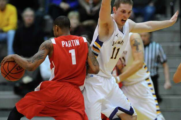 UAlbany's Luke Devlin, right, defends Boston University's Darryl Partin during the first half of UAlbany's 81-78 loss at the SEFCU Arena on Monday night Feb. 6, 2012 in Albany, NY.    (Philip Kamrass / Times Union ) Photo: Philip Kamrass / 00016316A