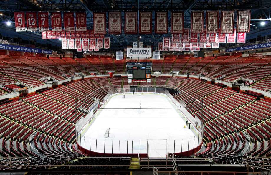 In this photo taken Tuesday, Dec. 18, 2012, championship banners and retired numbers of the Detroit Red Wings hockey team hang from the rafters above the ice at Joe Louis Arena in Detroit. The NHL lockout that's already wiped out the first three months of the season is taking its toll on small businesses in many of the NHL's markets. (AP Photo/Paul Sancya, File) Photo: Paul Sancya
