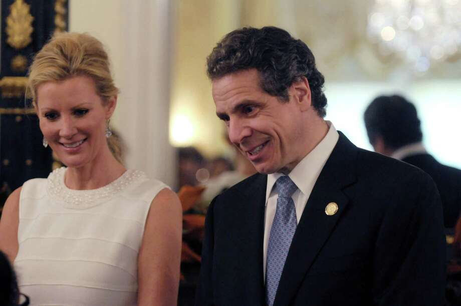 Sandra Lee, left, the governor's companion and Food Network star and Governor Andrew Cuomo greet visitors to the Executive Mansion on Sunday, Jan. 1, 2012 during an open house in Albany.    (Paul Buckowski / Times Union) Photo: Paul Buckowski / 00015939A