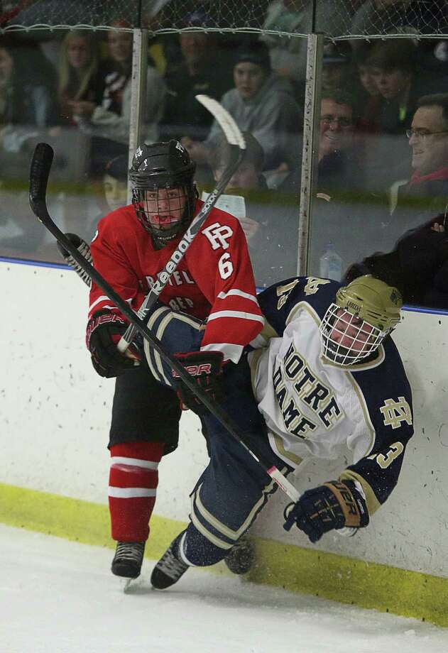 Mike Ross Connecticut Post freelance -Fairfield Prep's #6 Kevin Brown checks Notre Dame Fairfield # 13 Erik Laaksonen into the boards during Thursday evening match-up. Photo: Mike Ross / @www.mikerossphoto.com
