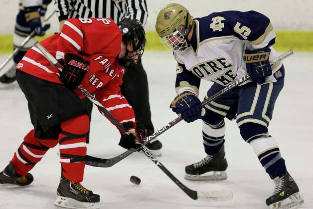 Mike Ross Connecticut Post freelance -Fairfield Prep's #8 David White and Notre Dame of Fairfield 's # 15 Sal Sereno face off during Thursday evening match-up held at Milford Ice Pavilion. Photo: Mike Ross / @www.mikerossphoto.com
