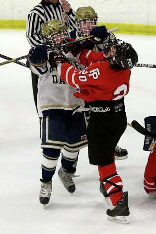 Mike Ross Connecticut Post freelance -Notre Dame Fairfield's #14 Cam Barquinero and Fairfield Prep's #20 Tim Edmonds get into a brawl during second period action on Thursday evening match-up. Photo: Mike Ross / @www.mikerossphoto.com
