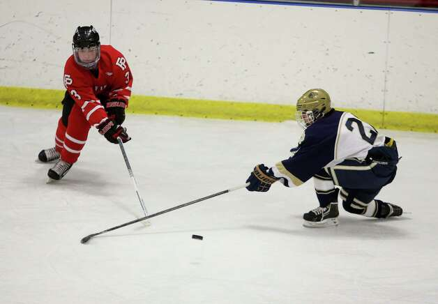 Mike Ross Connecticut Post freelance -Fairfield Prep's #3 Matt Wikman and Notre Dame of Fairfield's #22 Matt Khorasani battle for the puc during Thursday evening match at Milford Ice Pavilion. Photo: Mike Ross / @www.mikerossphoto.com