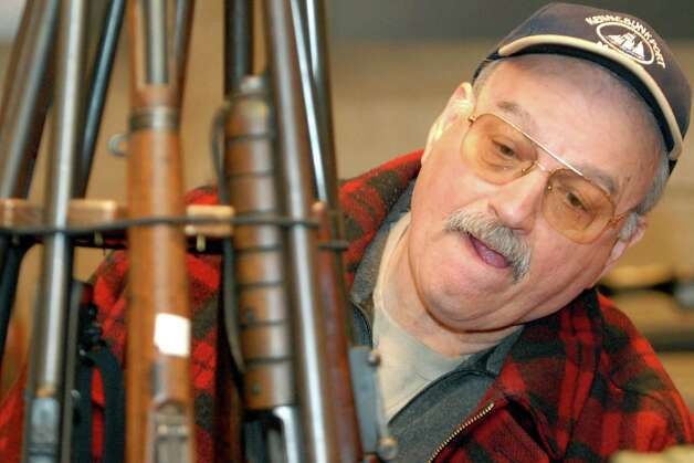 Target shooter and gun collector Gary Sandike of Oneonta  looks over guns for sale at the Gun Show on Saturday, Jan. 20, 2007, at the Empire State Plaza Convention Center in Albany, N.Y. (Cindy Schultz/Times Union archive) Photo: CINDY SCHULTZ / ALBANY TIMES UNION