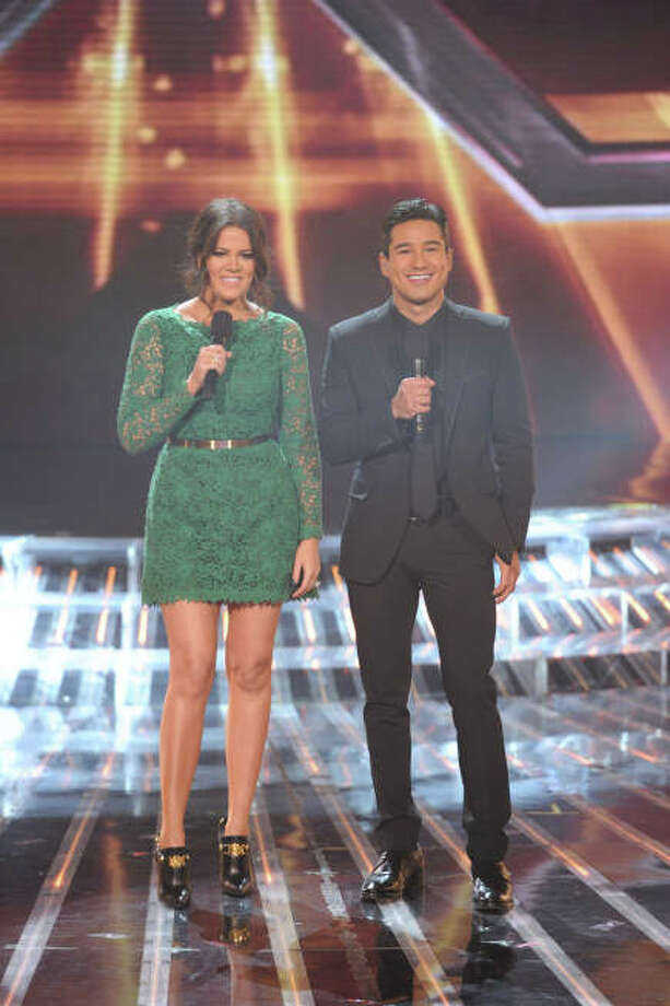 THE X FACTOR:  Hosts Khloe Kardashian Odom and Mario Lopez  during  THE X FACTOR Finale, Thursday, Dec. 20 (8:00-9:00PM ET/PT) on FOX.  CR: Frank Micelotta / FOX.